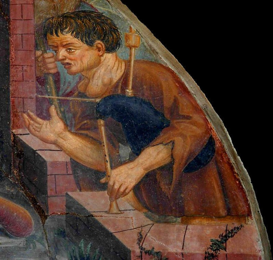 Found it! The shepherd who gladdens the Holy Family with his bagpipe in the 16th-century Nativity fresco over the main door of the Aosta Cathedral has the swollen throat typical of a greatly enlarged thyroid gland.