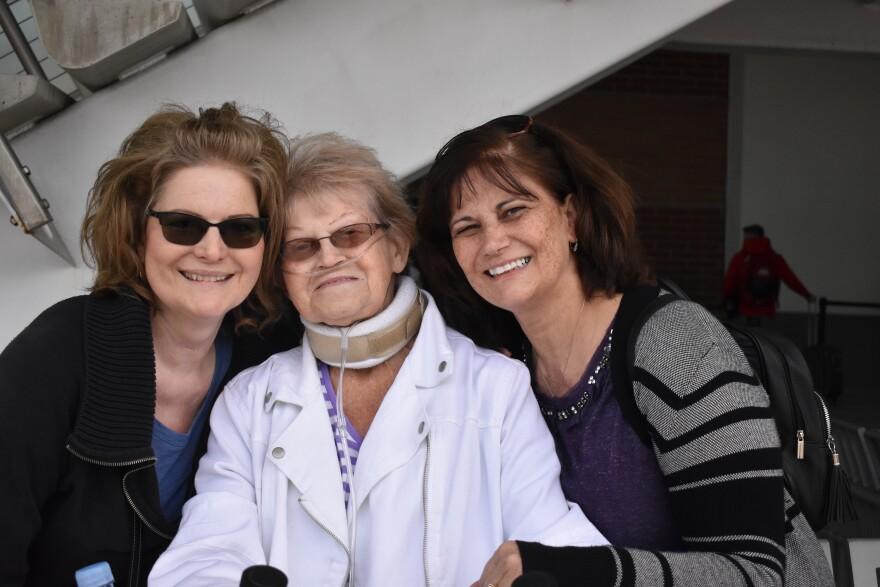 three women smile at the camera