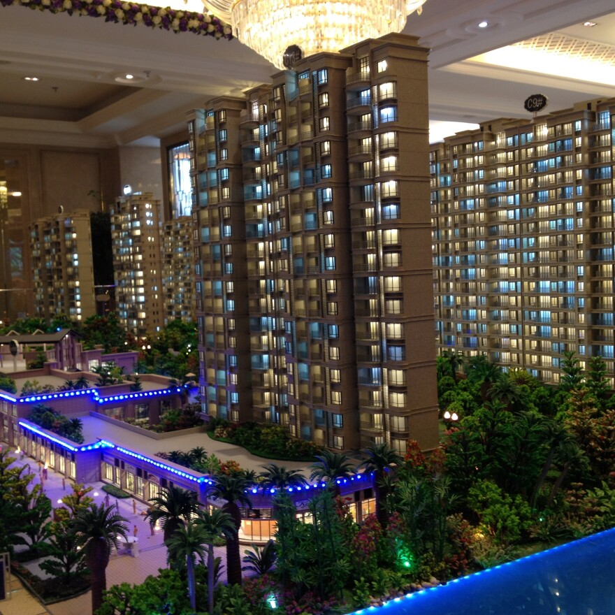 Real estate agents in Wuxi say construction continues in the city despite a lack of demand. Here, models of new apartment buildings are on display at a local sales office.