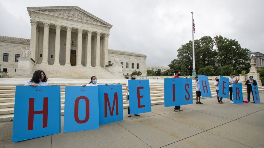 Deferred Action for Childhood Arrivals (DACA) students gather in front of the Supreme Court in Washington on June 18.