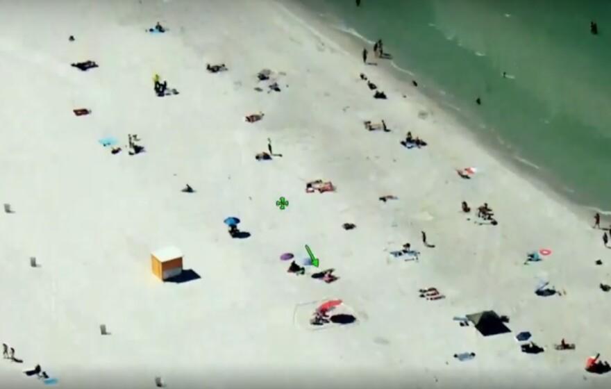 video still of beachgoers