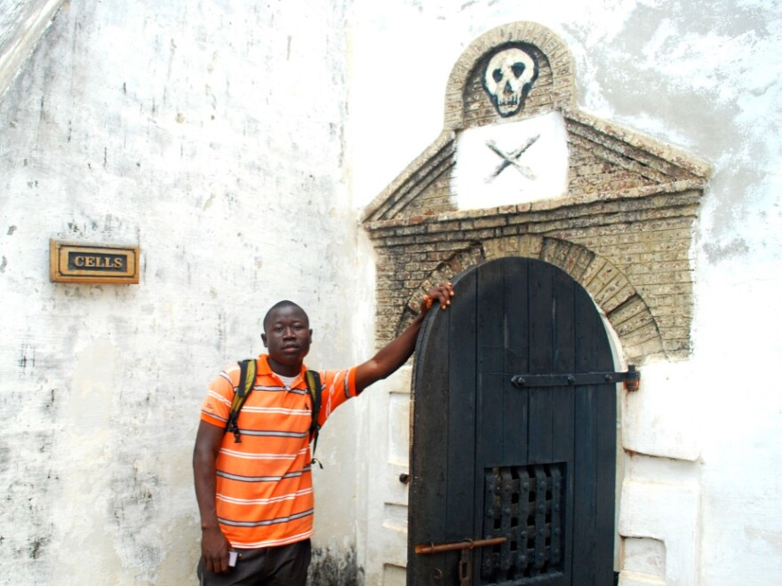 George Mwinnyaa on his visit to the slave castle at Cape Coast in his homeland of Ghana. The door leads to the cells where captives who were resistant were held prior to being sent over the ocean as slaves.