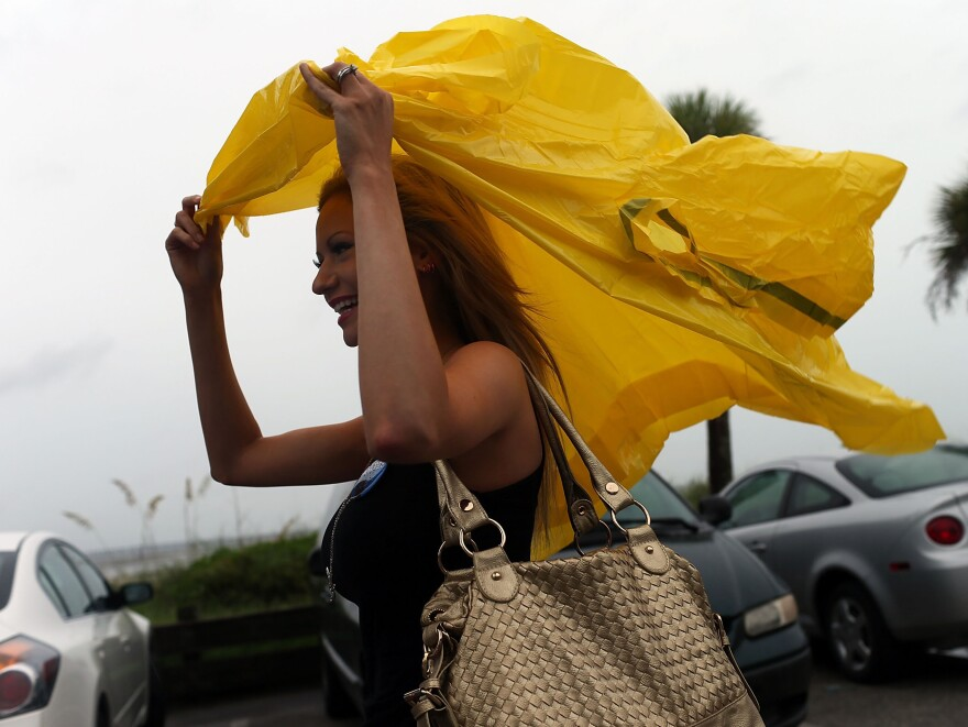 Republican Rachel Bolch Thach held tight to her poncho  Sunday in Tampa.