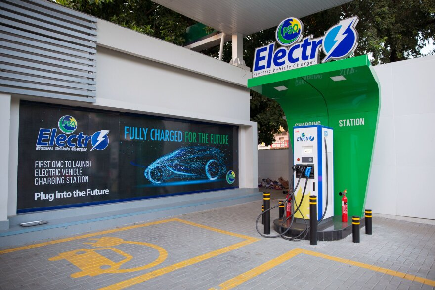 An electric car charging station installed at a local gas station in Islamabad. The government's new electric vehicle policy aims to lessen Pakistan's terrible air pollution, and it reduces taxes on imported parts to incentivize sales. It covers motorbikes, rickshaws, buses and trucks, vehicles which dominate the road in Pakistan, but cars are exempt.