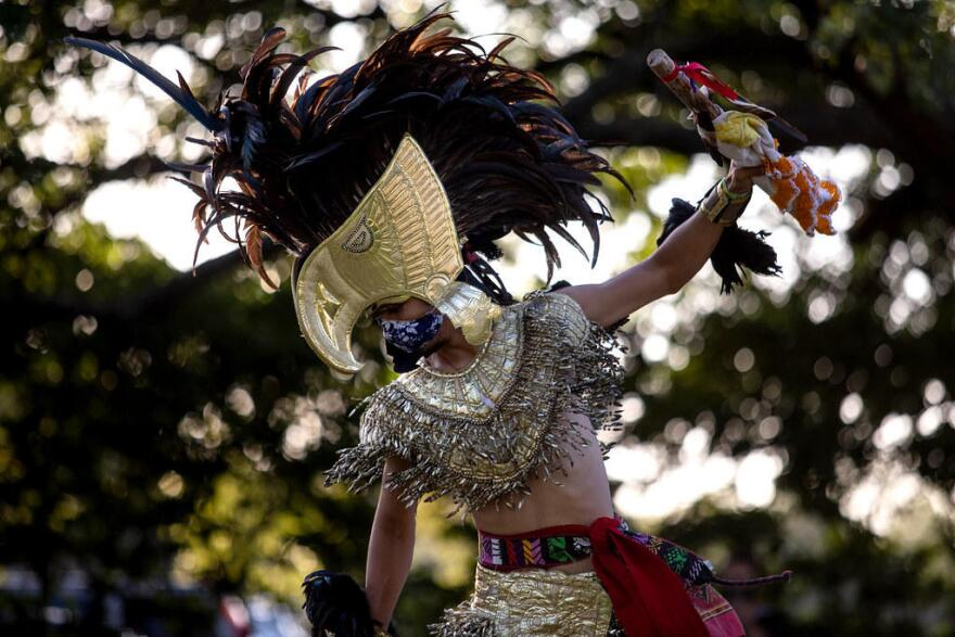 Mario Ramirez performs a ceremonial dance.