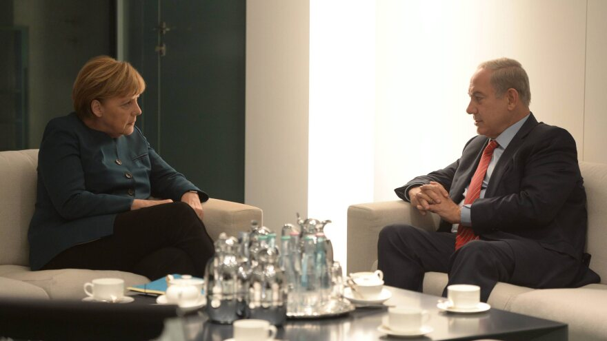 German Chancellor Angela Merkel meets with Israeli Prime Minister Benjamin Netanyahu in Berlin on Wednesday.