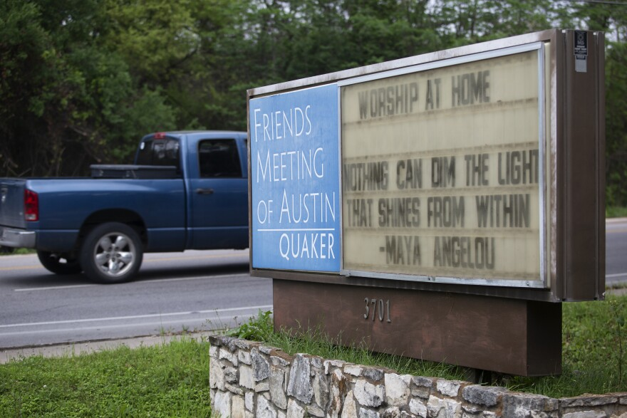 A sign outside a Quaker meeting house in Austin encourages people to worship at home during the coronavirus pandemic.