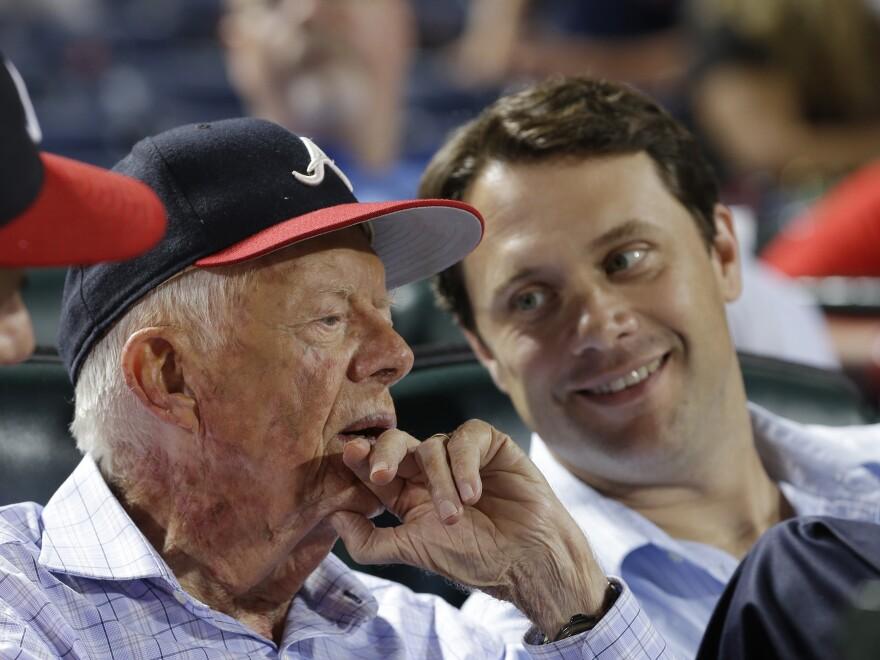 Former President Jimmy Carter and his grandson, Georgia state Sen. Jason Carter, watch a baseball game between the Atlanta Braves and Philadelphia Phillies in Atlanta on Aug. 14.
