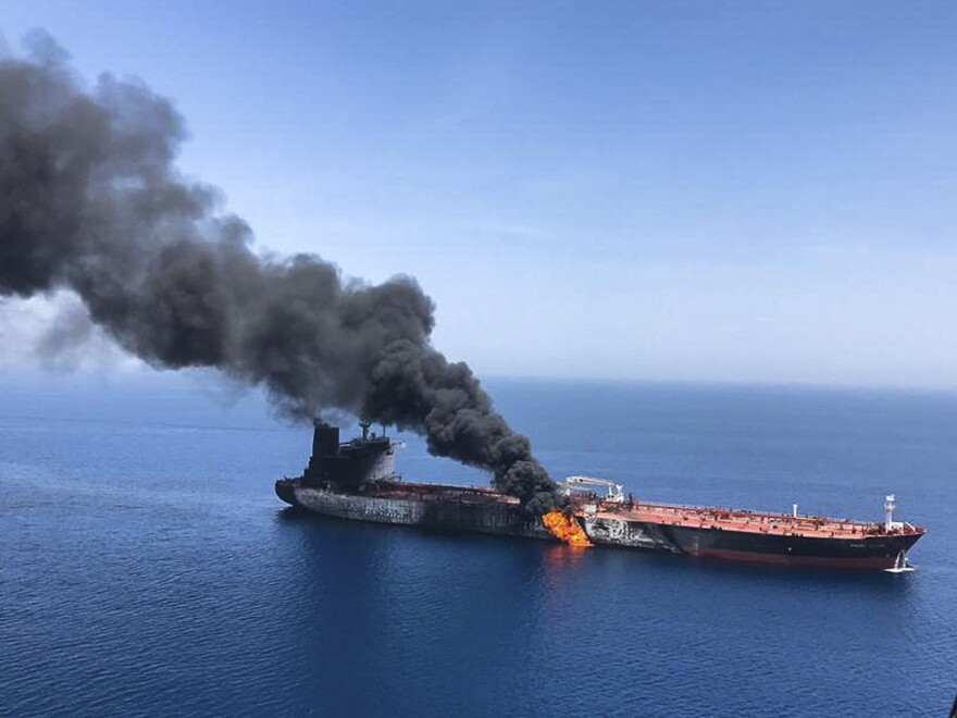 An oil tanker burns in the sea of Oman on June 13. The U.S. says Iran is behind attacks on two oil tankers near the strategic Strait of Hormuz.