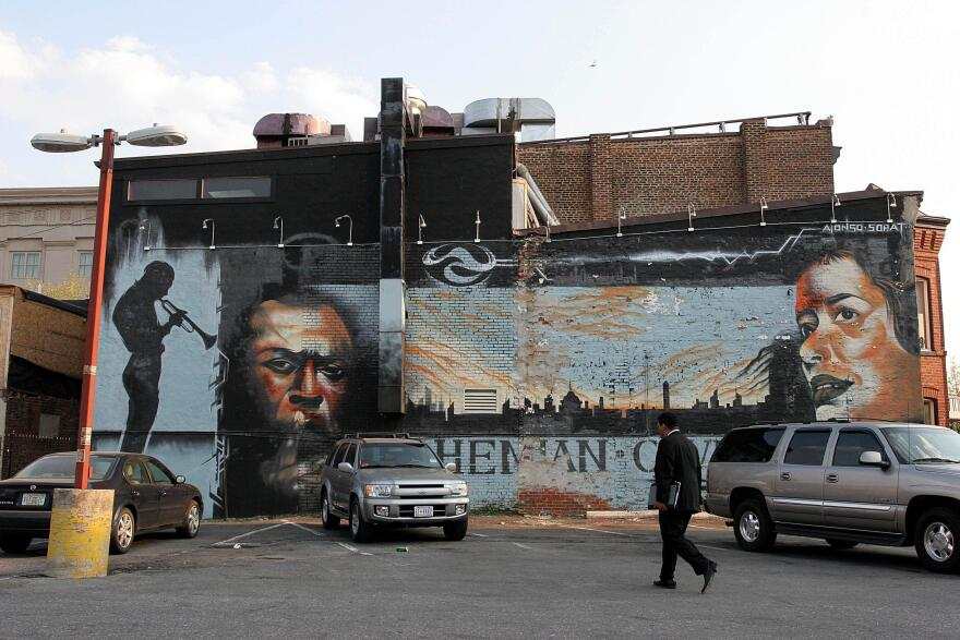A mural depicts jazz greats Miles Davis and Billie Holiday on the side of the Bohemian Caverns club on Washington, D.C.'s U Street in 2005.