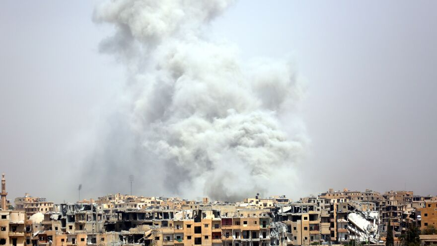 Smoke billows into the sky following a coalition air strike last July, just one month after the U.S.-led forces began their final push into the city Islamic State once considered its capital.