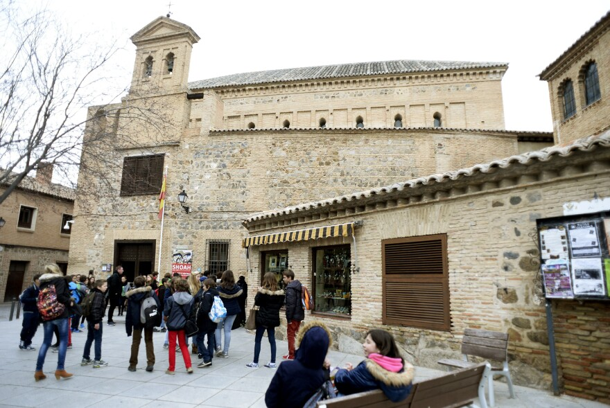 Children gather outside the El Transito synagogue and Sephardic Museum in Toledo, Spain. Founded in 1357, the synagogue was converted into a church following the expulsion of Jews from Spain in 1492. Spain is now preparing to pass a law that would allow descendants of the expelled Jews to receive Spanish citizenship.