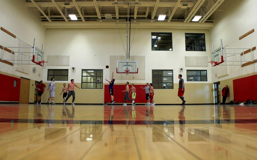 Bison rims factor into this lunch-hour game of pickup basketball at a Lincoln, Nebraska YMCA.