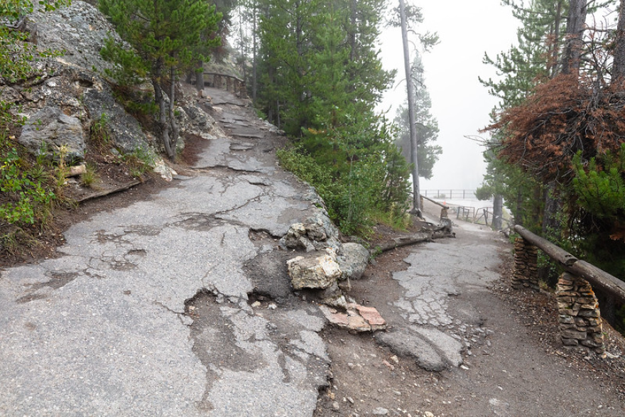 Damage to the Brink of the Lower Falls Trail in Yellowstone National Park is an example of deferred maintenance in national parks.