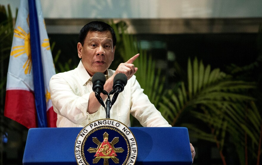 Philippine President Rodrigo Duterte answers questions from the press at Manila International Airport on March 23. Jude Sabio, a lawyer in the Philippines, has filed a complaint at the International Criminal Court accusing Duterte of crimes against humanity.