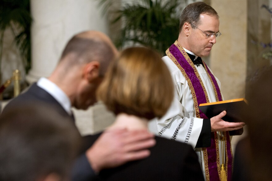 The Rev. Paul Scalia leads a prayer during a private ceremony for his father, Justice Antonin Scalia, on Friday in the Great Hall of the Supreme Court.