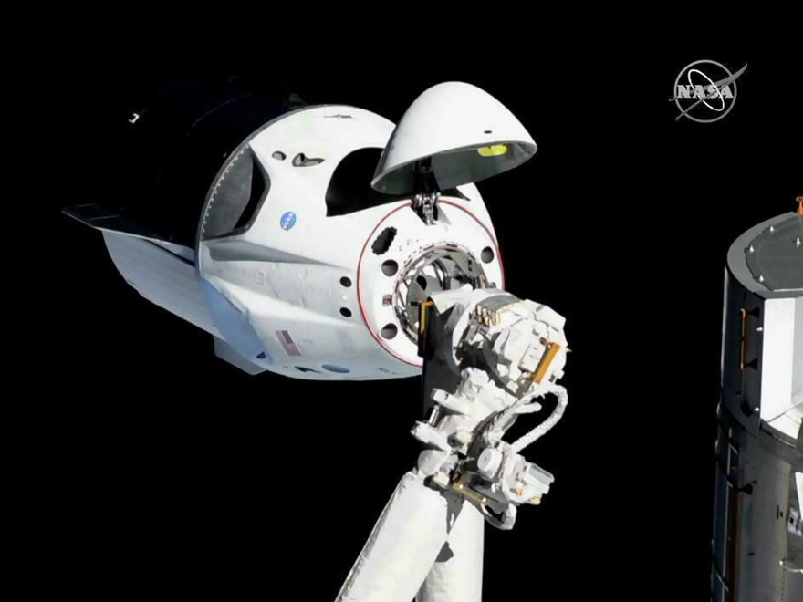 In this photo provided by NASA, the SpaceX Crew Dragon is pictured just beside the International Space Station. SpaceX's new crew capsule arrived at the station on Sunday in a remarkable moment for commercial space exploration.