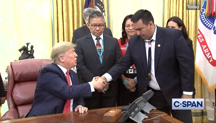 President Trump and Crow Chariman AJ Not Afraid shake hands during their meeting on November 26.