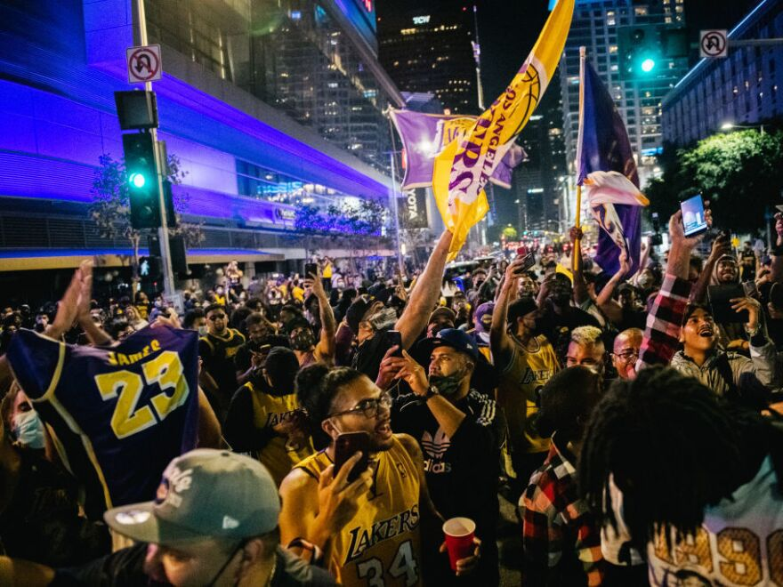 Lakers fans celebrate in front of the Staples Center on Sunday in Los Angeles. People gathered to celebrate after the Lakers' defeat of Miami for the NBA championship.