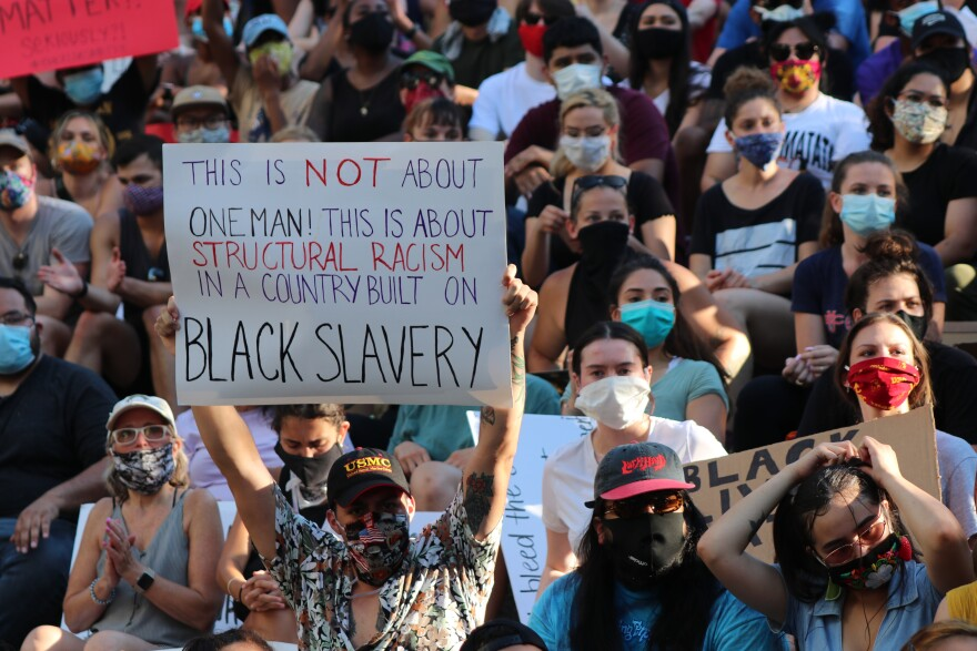 Demonstrators at Arneson River Theatre protest police brutality and in support of Black Lives Matter on June 8, 2020.