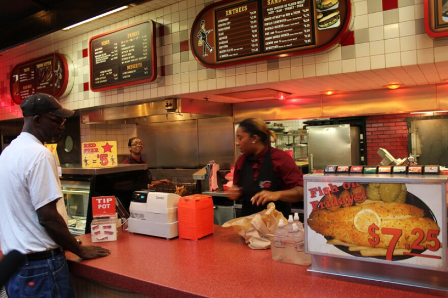 Picture of a customer ordering at the counter of a Gates Bar-B-Q location