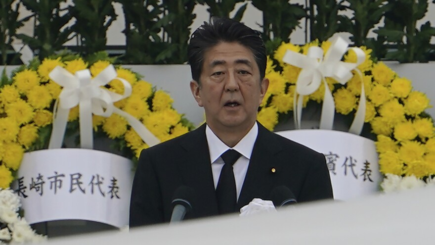 Japanese Prime Minister Shinzo Abe speaks during a ceremony at the Hiroshima Peace Memorial Park on Aug. 6 to mark the 75th anniversary of the U.S. atomic attack. Abe announced his resignation Thursday.
