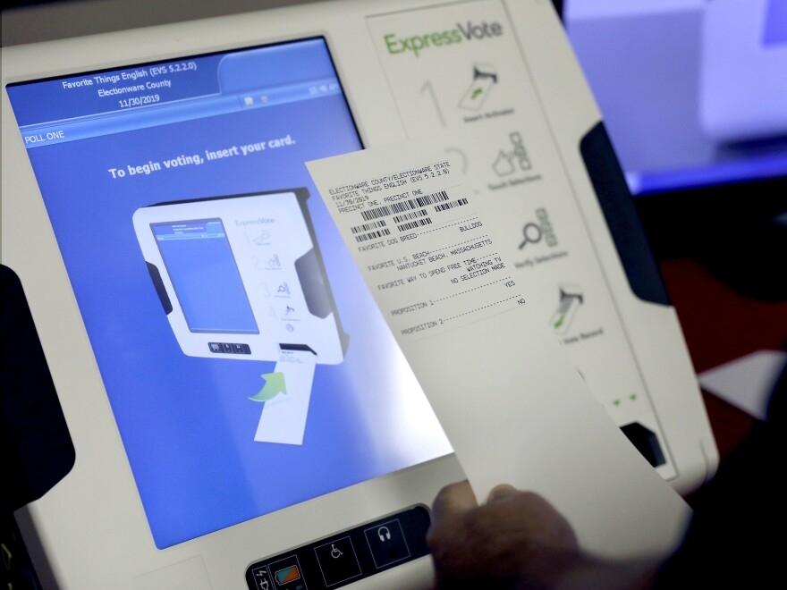 An electronic voting machines that produces a paper receipt from Election Services & Software. The company is among those bidding to replace all of Georgia's voting machines but close relationships between state officials and ES&S have raised questions about the fairness of the bidding process.