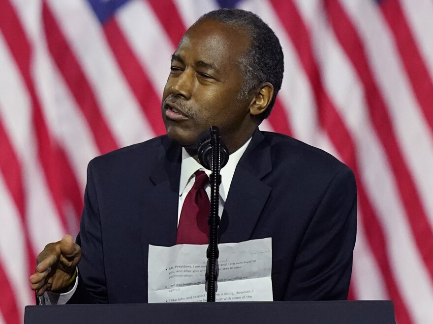 Secretary of Housing and Urban Development Ben Carson holds notes as he speaks during a campaign event before President Donald Trump at the Cobb Galleria Centre, in Atlanta in September. Carson is the latest White House official to test positive for the coronavirus.