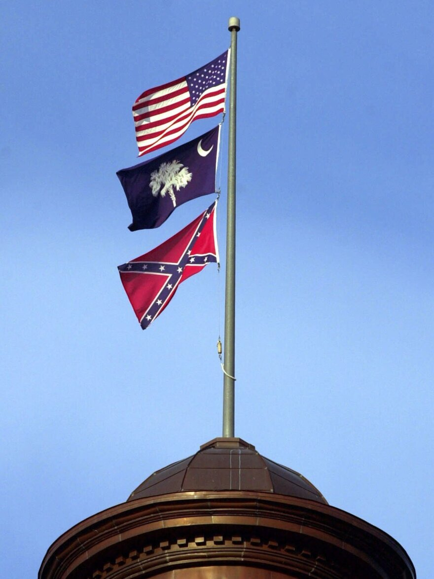 The Confederate flag flies on the dome of the Statehouse in Columbia, S.C., in 2000.