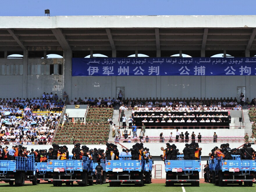 Trucks packed with criminals and suspects at a mass sentencing rally at a stadium in Yili, in Xinjiang province, on Tuesday.