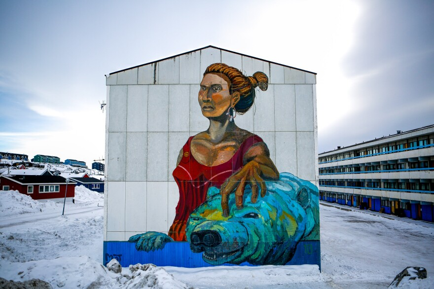 An artist's rendering of the Woman of the Sea, part of an Inuit legend, decorates an apartment block in downtown Nuuk, Greenland. Although Inuit culture was beaten down by Danish colonizers, it's now changing and thriving.