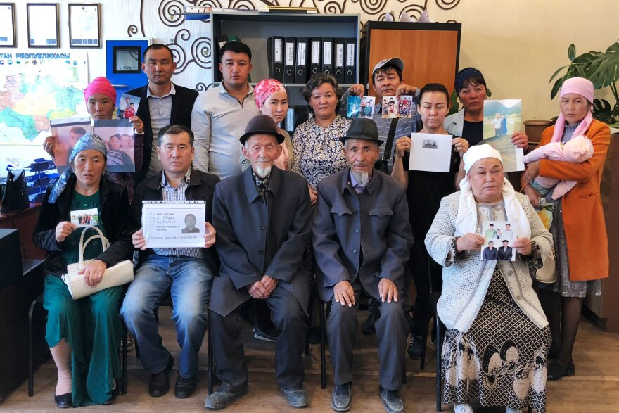 "A group of ethnic Kazkhs stand together at the offices of Atazhurt in Almaty, displaying photos of their missing loved ones in the Xinjiang region of China, where government officials have rounded up the mostly Muslim ethnic minorities of the region and placed them inside so-called ""re-education"" camps."