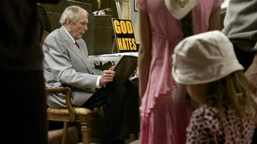"Westboro Baptist Church founder Fred Phelps' followers believe ""they're not going to feel the sting of death,"" one of his sons says. Phelps, who's now in hospice care, is seen here at the Topeka, Kan., church in 2006."