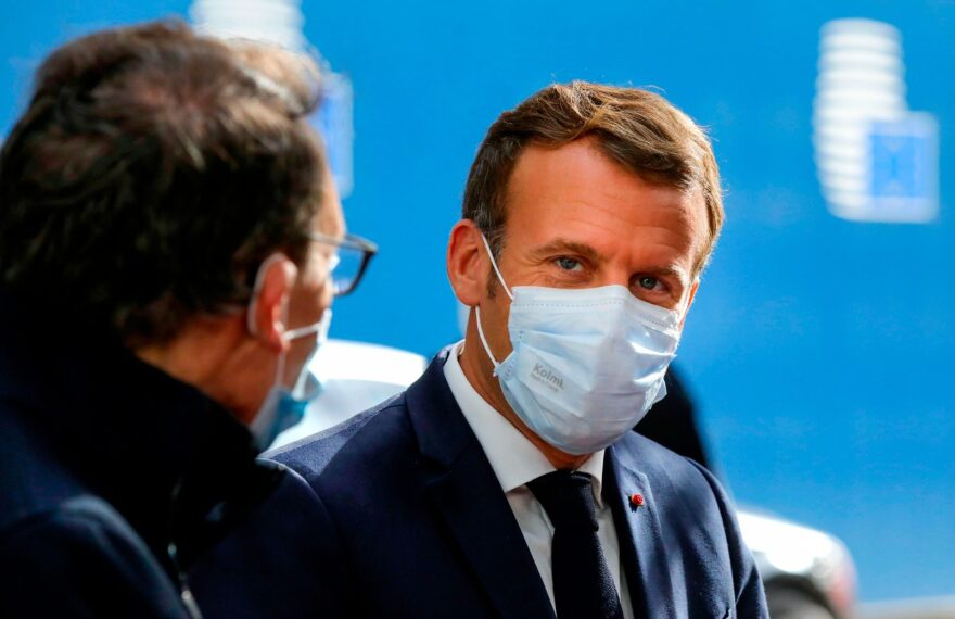 French President Emmanuel Macron wearing a face mask arrives ahead of a two days European Union (EU) summit at the European Council Building in Brussels.
