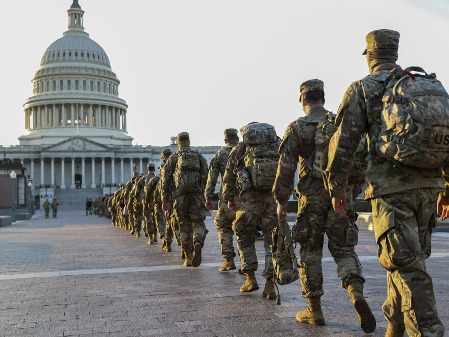 Members of the National Guard arrive at the U.S. Capitol on Tuesday. Following the insurrection on Jan. 6, 20,000 National Guard troops are expected to be involved in securing President-elect Joe Biden's inauguration next week.