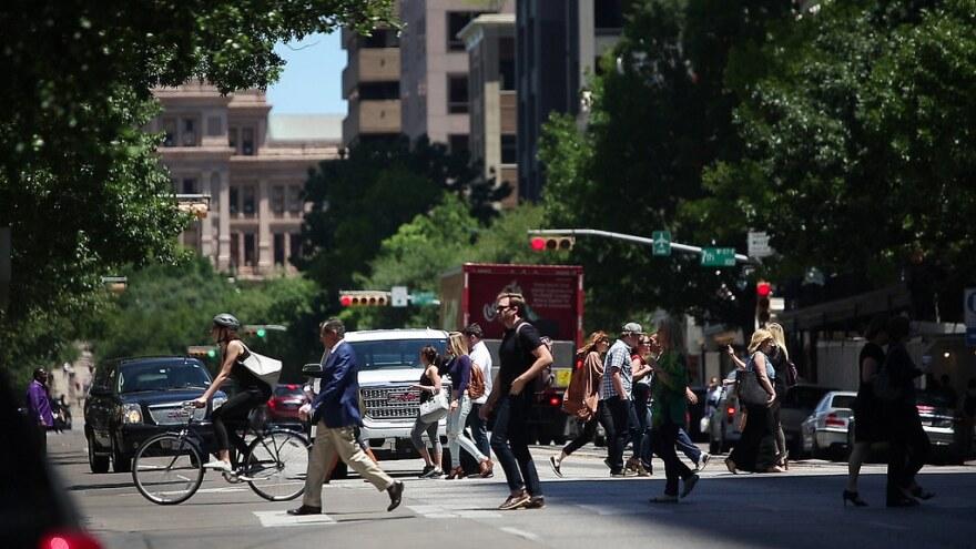 Pedestrians cross the street in downtown Austin.