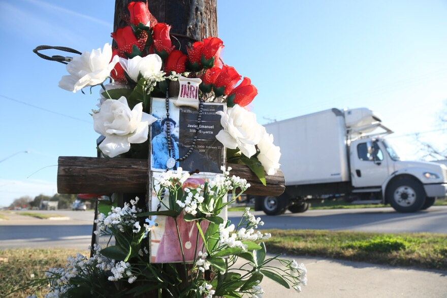 A memorial on a light pole at the intersection of Seventh Street and Springdale Avenue in East Austin.