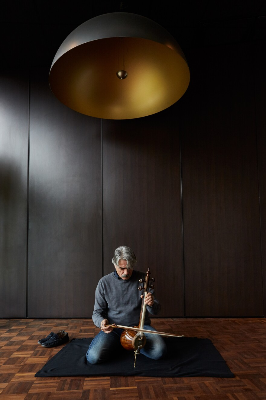 Kalhor plays the <em>kamancheh</em> in 2017. When he left Iran at age 17, he carried only two items with him: a small backpack and his main musical instrument, the <em>kamancheh</em>.
