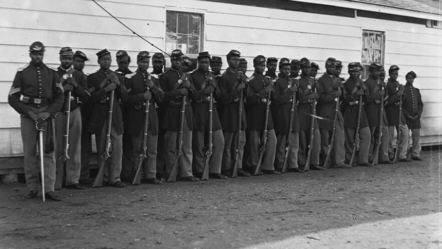Soldiers of the 4th U.S. Colored Infantry Regiment, E Company, pose for a photograph at Fort Lincoln, Md., one of several fortifications ringing Washington, D.C., during the Civil War.