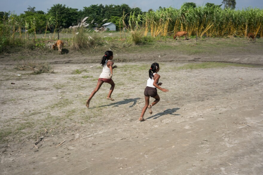 Children play on the banks of the Brahmaputra River.