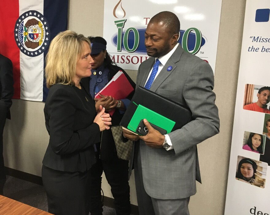 St. Louis Public Schools Superintendent Kelvin Adams and Commissioner of Education Margie Vandeven speak with each other after the State Board of Education granted St. Louis Public Schools full accreditation.