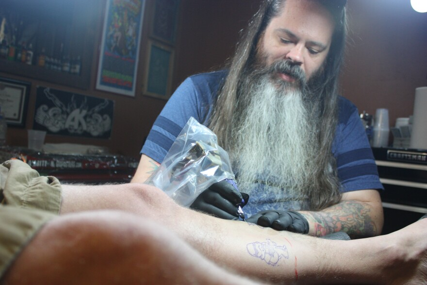 Chad Wells is the owner of Wells & Co. Custom Tattoos in Dayton's Fire Blocks District