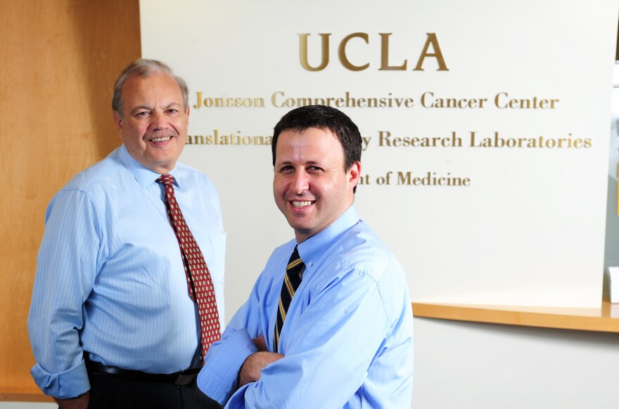 Dr. Richard Finn (right) at the UCLA Geffen School of Medicine and his colleague Dr. Dennis Slamon at the Revlon/UCLA Women's Cancer Research Program.