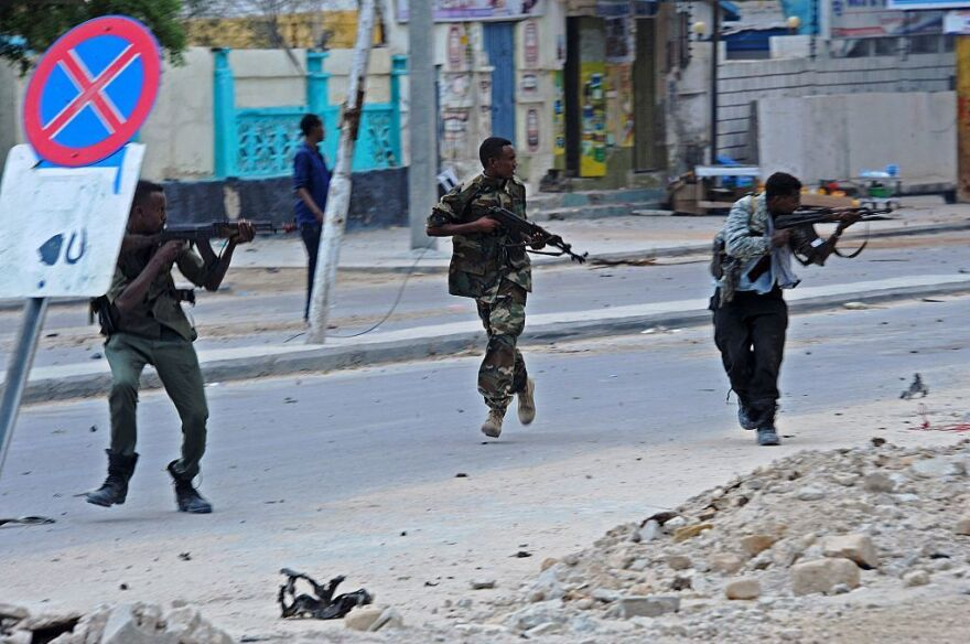 Somali security forces intervene after a car bomb attack claimed by al-Qaida-affiliated al-Shabab militants exploded near Hotel Naso Hablod in Mogadishu on Saturday.