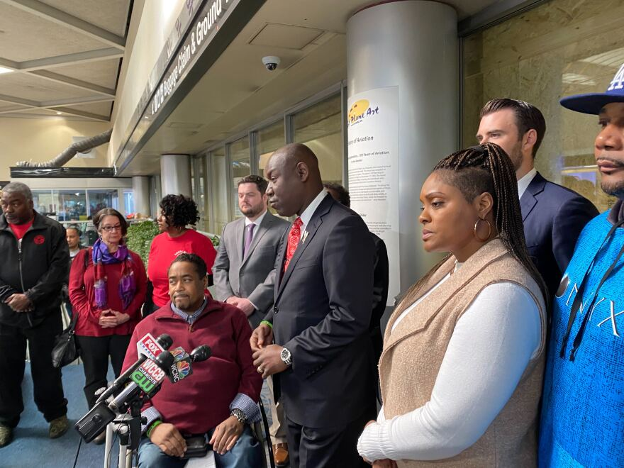 Kendrick Hudson's father Leon Hudson, lawyer Ben Crump, and mother Erika Vernon speak at Charlotte Douglas Airport