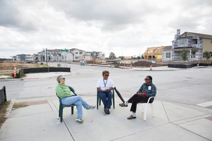 Kathy Van Sluyters (left), Barbara Carr and Colleen Dickinson chat on a recently finished sidewalk across from Wildflower Terrace, a mixed-income apartment building in the Mueller development for people ages 55 and over.