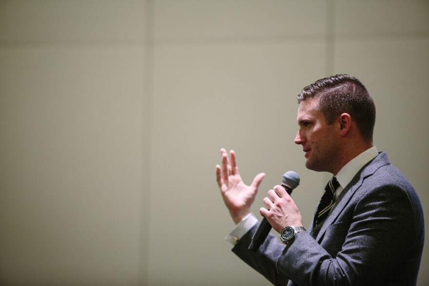 "Richard Spencer addresses a room of press and conference attendees at a news conference held by the National Policy Institute during its ""Become Who We Are"" event in Washington, D.C. Prior to the news conference, which was held in the same room as the broader NPI event, Spencer told journalists they could not take photos of the room because attendees could be identified without their permission."
