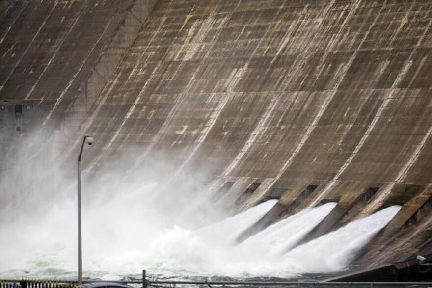 The Lower Colorado River Authority opened floodgates at the Mansfield Dam to release water from Lake Travis, which is 134 percent full.