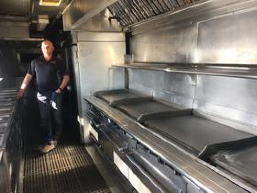 The interior of a commercial kitchen at a fire camp is essentially a stainless steel hallway full with with stoves, fridges, deep fryers and griddles.