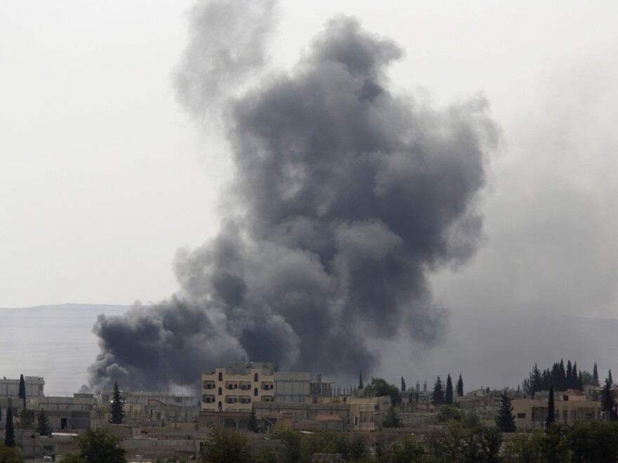 Smoke rises from the Syrian town of Kobani, seen from near the Mursitpinar border crossing on the Turkish-Syrian border in the southeastern town of Suruc, Sanliurfa province, on Friday.